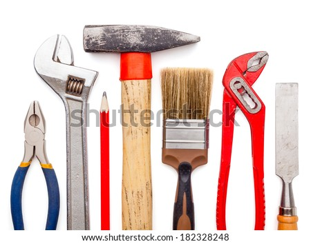 Various old used tools isolated on white background