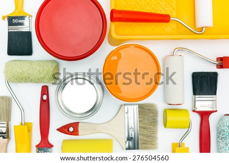 various painting tools and accessories for home renovation on white background - stock photo