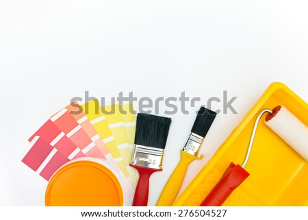 various painting tools and color palette on white background