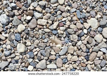 Various pebble stones floor background. - stock photo