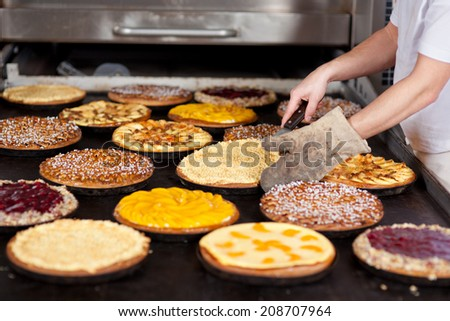 various pies on oven tray at bakery - stock photo