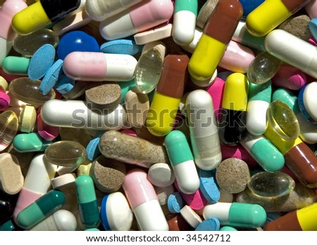 Various pills and capsules in macro view.  All trademarks and numbers removed.