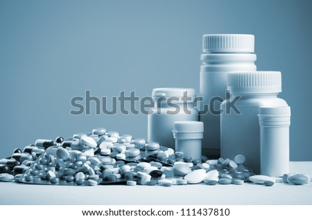 Various pills, capsules, dragee and white bottles. Toned - stock photo