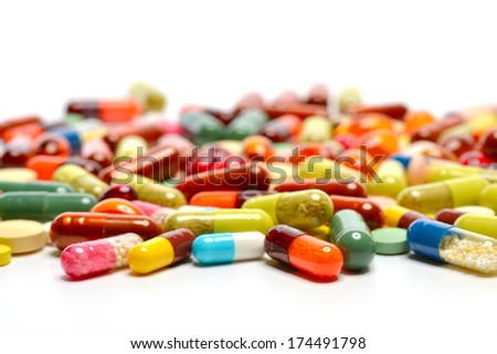 various pills isolated on white backround - stock photo
