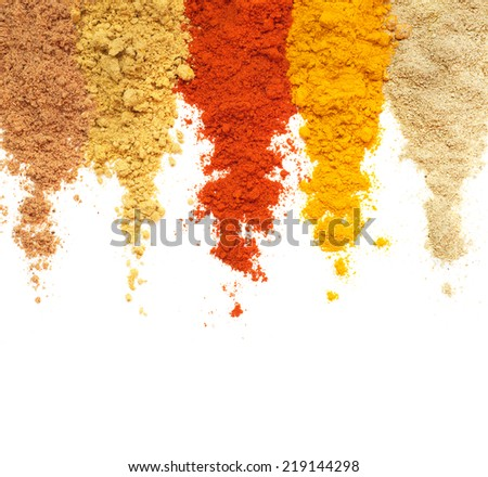 Various powdered spices over white background - stock photo