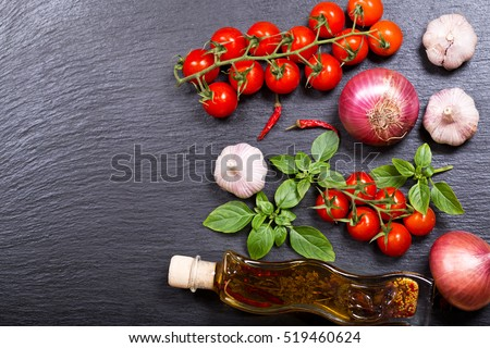various products for cooking on dark board, top view with copy space