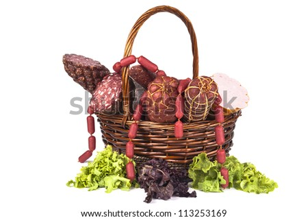 Various salami products in a basket isolated on white background