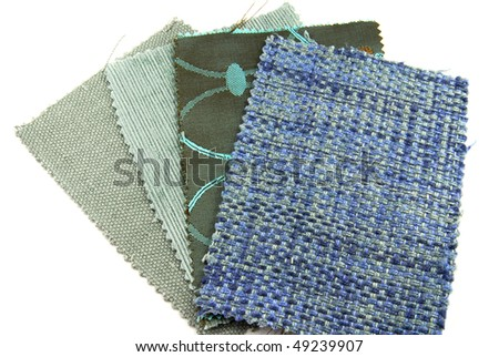 various samples of fabric choice in blue color and texture isolated on white - stock photo