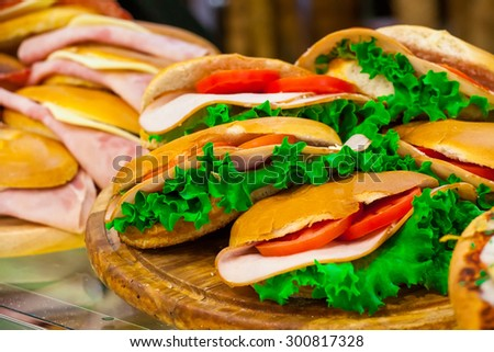 Various sandwiches on a shop counter - stock photo