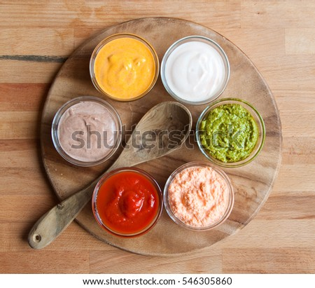 Various sauces on wood