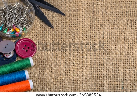 Various sewing accessories on a textile background.
