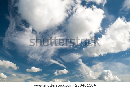 Various shape white clouds on blue sky