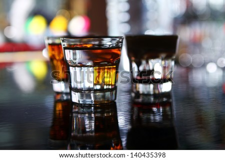 Various shots on a bar stage on a glass table - stock photo
