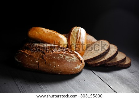 Various sliced bread on wooden table close-up - stock photo