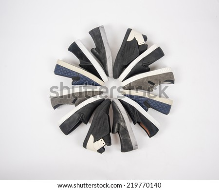 Various Slip on Sneakers on White Background - stock photo
