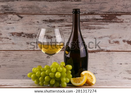 Various sorts of fruits, grapes and glass of the white wine