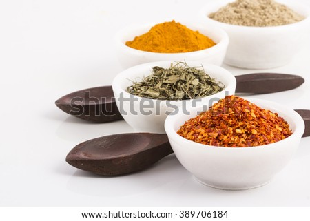 Various Spices and herbs in bowl in white   - stock photo