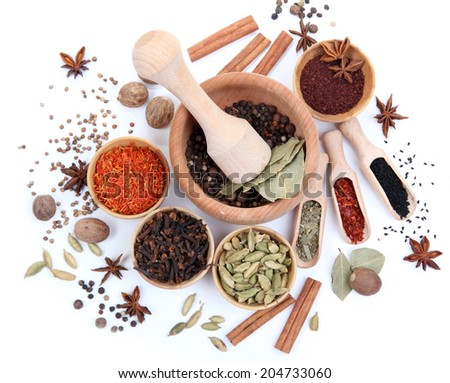 Various spices and herbs isolated on white - stock photo