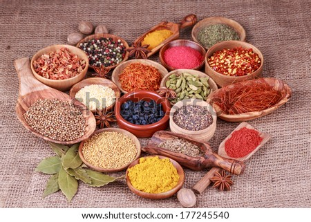 Various spices and herbs on a sack cloth - stock photo