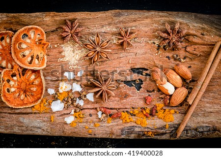 Various spices, herb  and ingredients on wooden table - stock photo