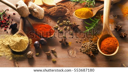 Various spices on a wooden board. Top view