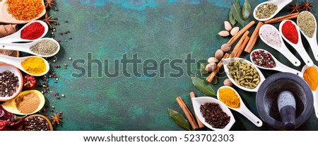 various spices on old green background, top view with copy space.