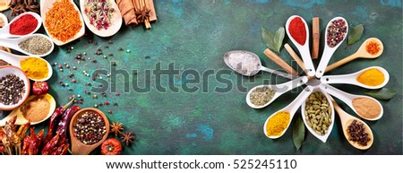 various spices on old green background, top view with copy space, banner