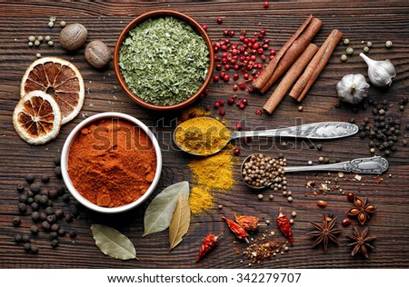 various spices on old wooden table