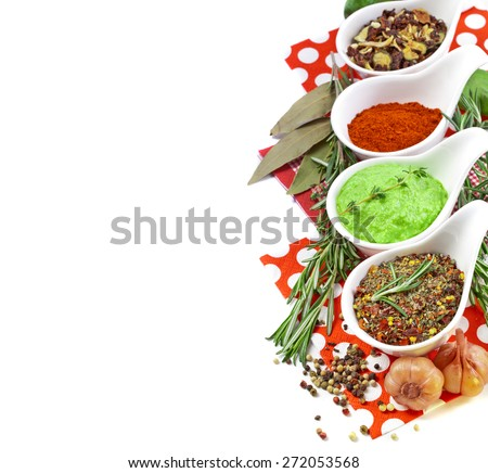 Various spices on white - stock photo