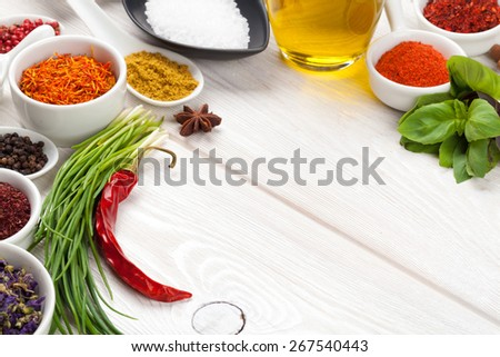 Various spices on white wooden background with copy space