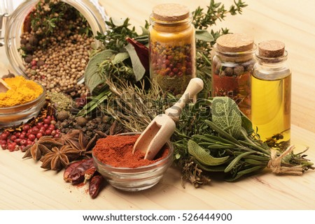 Various spices on wooden background.