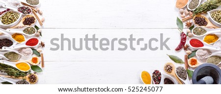 various spices on wooden background, top view with copy space, banner