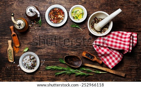 various spices on wooden background with space for text - stock photo