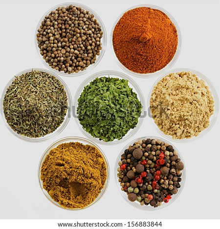 various spices presented in glass bowl - stock photo