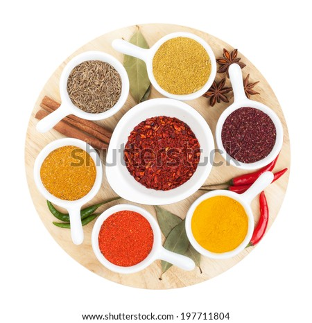 Various spices selection on cutting board. Isolated on white background - stock photo