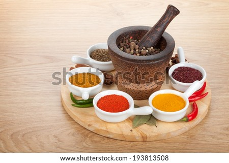 Various spices selection on wooden table - stock photo