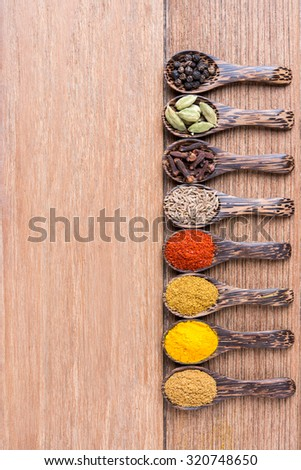 various spoon of Asian herb on the wooden table - stock photo