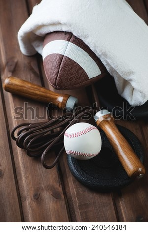 Various sports equipment over rustic wooden background, close-up - stock photo