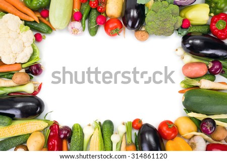 Various summer vegetables arranged around copy space - stock photo