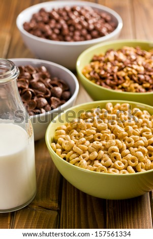 various sweet cereals in ceramic bowls