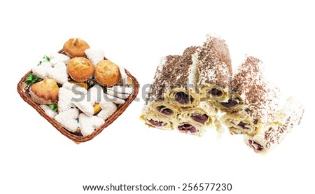 Various sweets in a basket and a cake on a white background