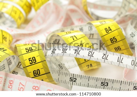 Various tape measure as background. - stock photo