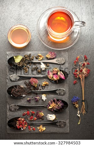 Various tea, dried herbs, dried berries and flowers. Top view, vertical