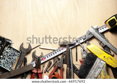 Various tools and instruments on wood board. - stock photo