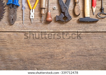 Various tools on  wooden background - stock photo