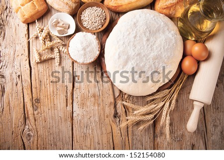 Various traditional ingredients for preparation of cooking of bread - stock photo