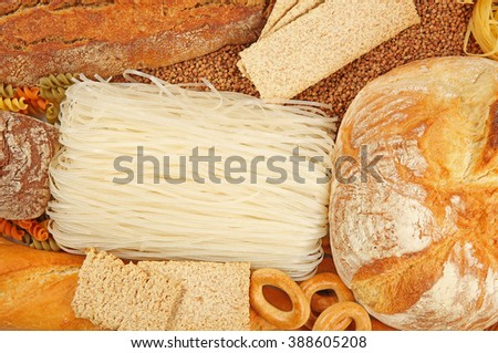 Various types of bread and pasta, top view - stock photo