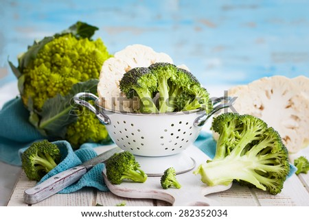 Various types of cabbage: romanesco, broccoli and cauliflower - stock photo