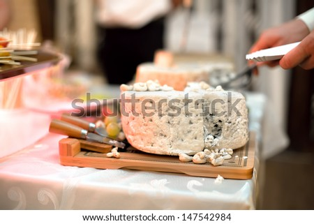 Various types of cheese as appetizers at dinner cocktail dress party