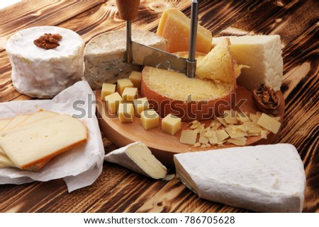 various types of cheese on rustic wooden table. cheese platter
